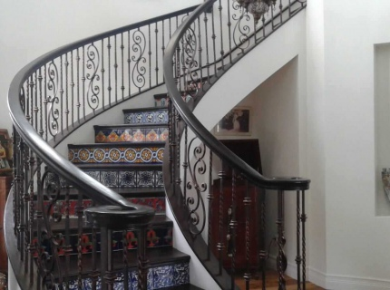 Suspended Rotunda Stair Case with Tile Risers